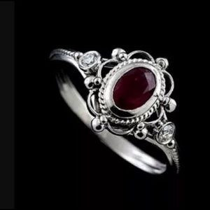 Gorgeous dark red ring
